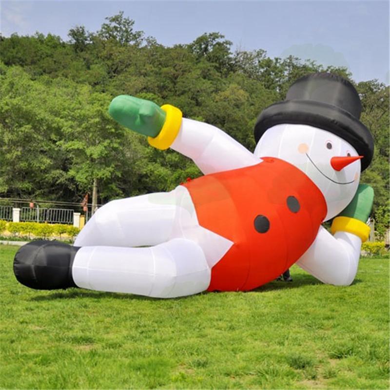 تخصيص زينة عيد الميلاد نفخ ثلج بالون الهواء الشتاء شخصية الكذب مع قبعة حمراء للولايات المتحدة الأمريكية