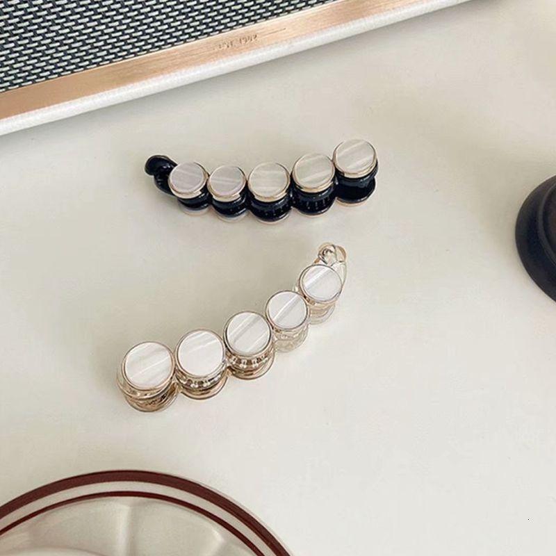 01 Japonya ve Güney Kore'nin yeni küçük koku, çok yönlü akrilik geometrik beyaz kabuk tütsü klibi, doğuda siyah yan klip