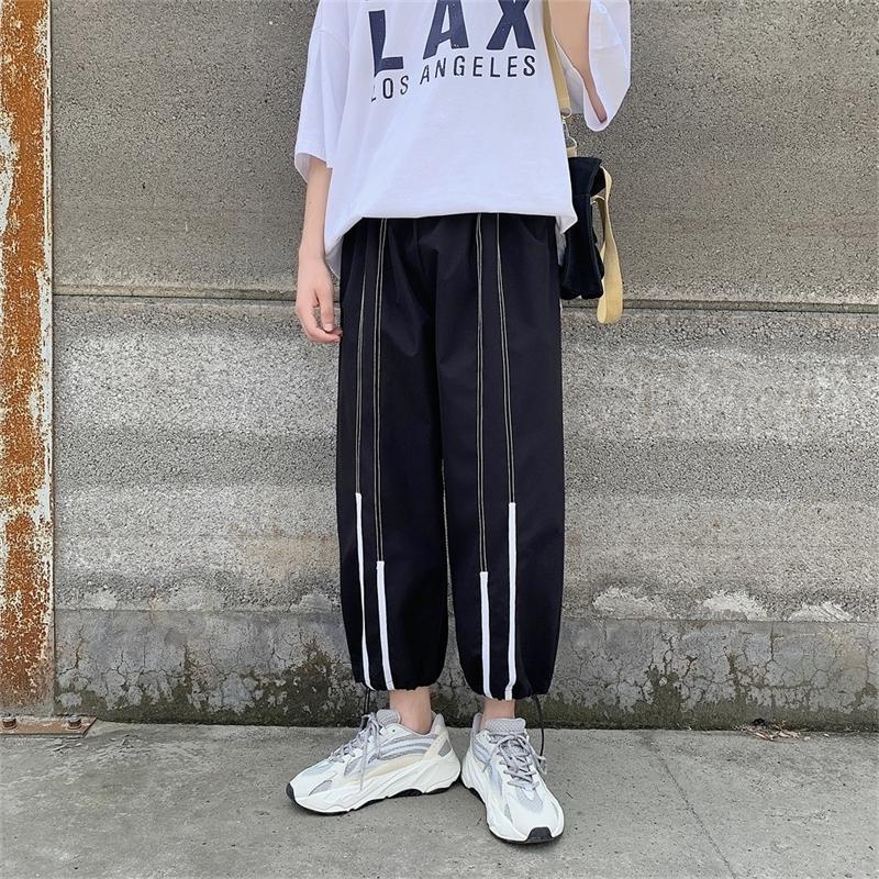 2021 Новая мужская полоса для полосы печатания досуга хлопка повседневные брюки мужские свободные брюки активные упругие белые / черный цвет бегуны спортивные штаны штанги L391
