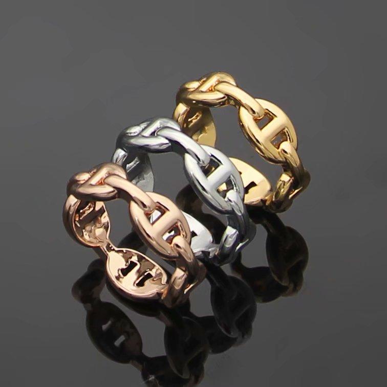Europa América estilo hombre señora mujeres titanio acero 18k oro hueco fuera H letras amantes anillos estrechos size6-9