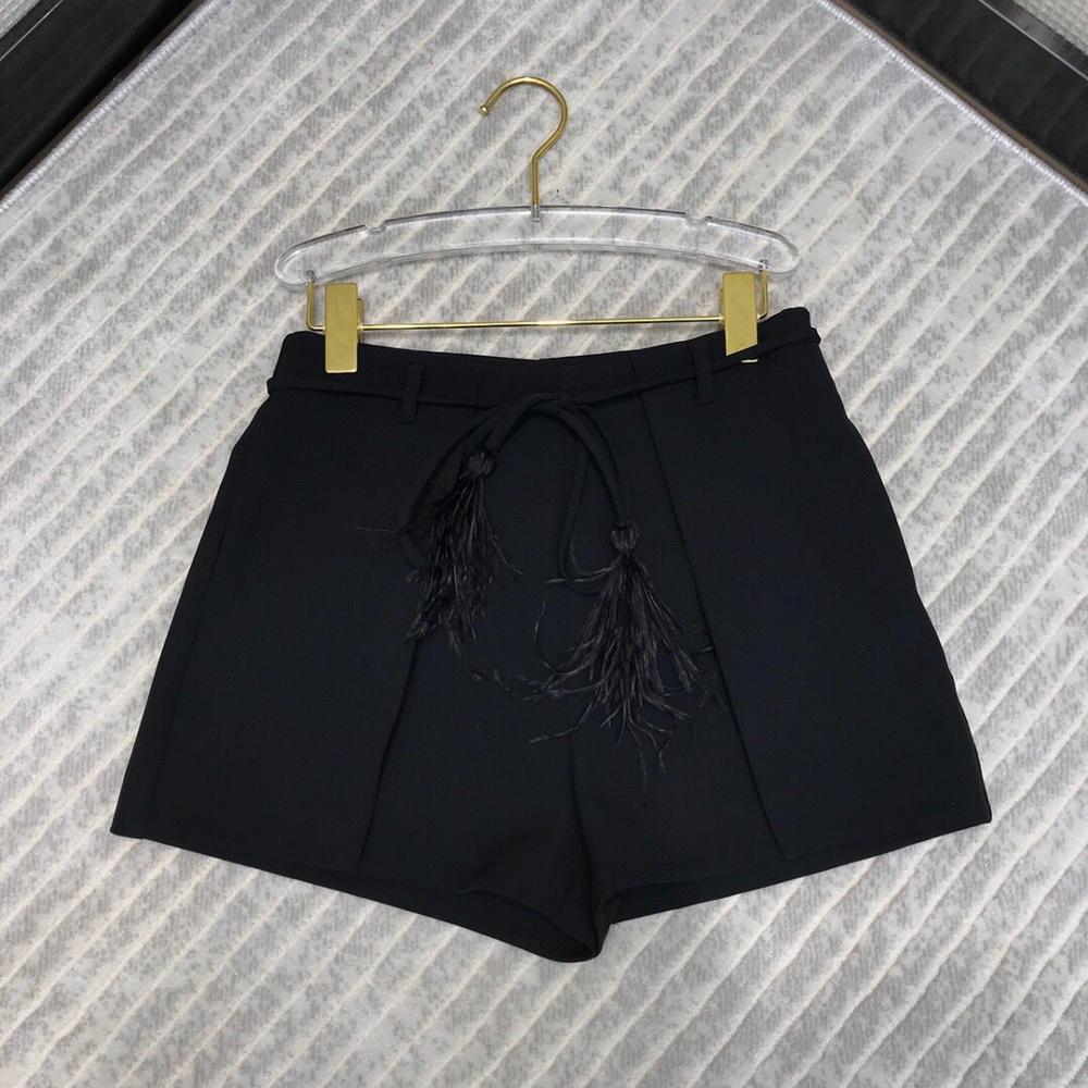 Couleur solide High-End 2020 été Taille haute taille Sweet short avec plumes de lacet de la ceinture de la bouteille de mode Femmes Vêtements Q0131