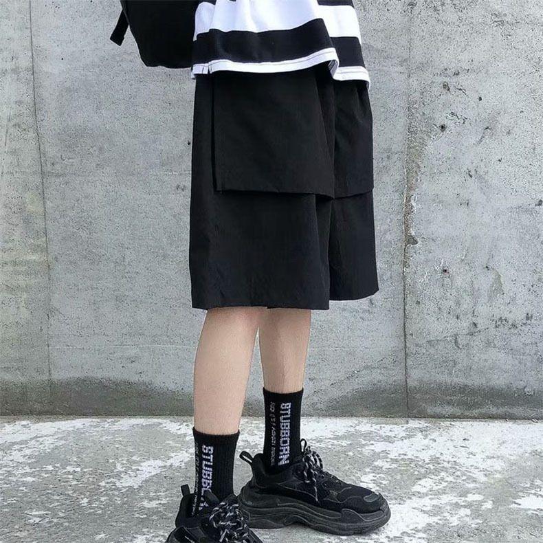 Pantalones cortos Marca de los hombres Insinuación suelta Capris Verano Fino elegante gota Sensación de tubos rectos Pantalones de pierna ancha Moda