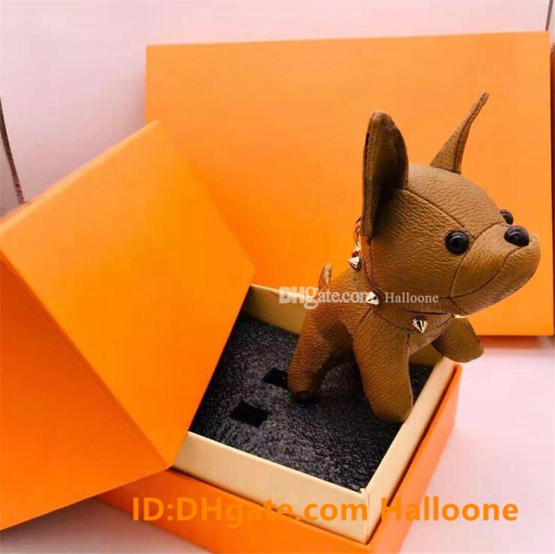 Großhandel Echte Leder Mode Luxurys Designer Schlüsselanhänger Brieftasche Anhänger Tasche Methode Dogfighting Puppe Anhänger Schlüsselanhänger 7 Farben Top Qualität