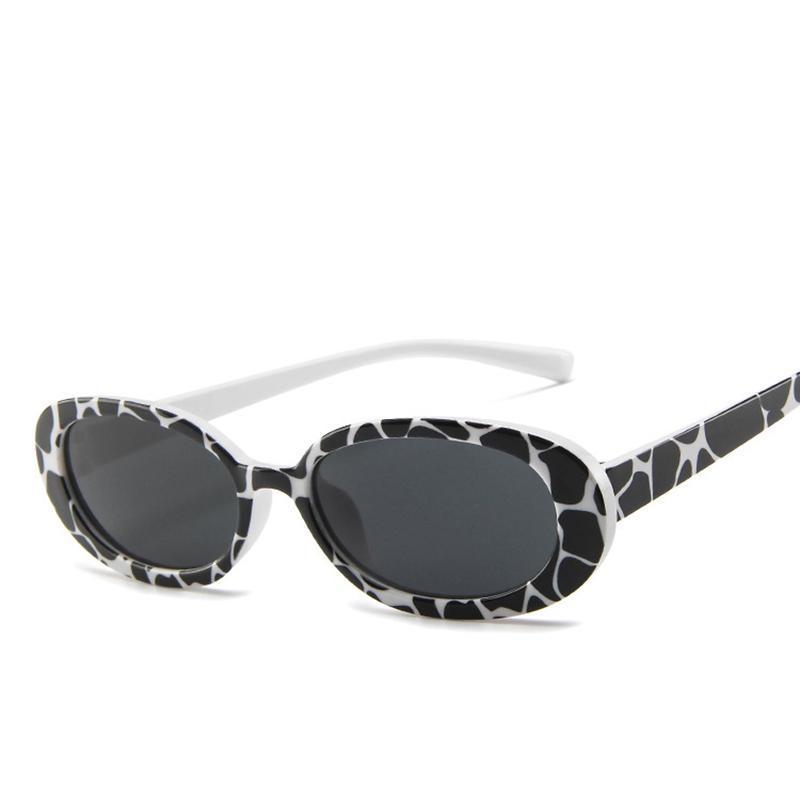 Sonnenbrille Das Kuhmuster mit weißen Rahmen ovalen Linsen für Frauen