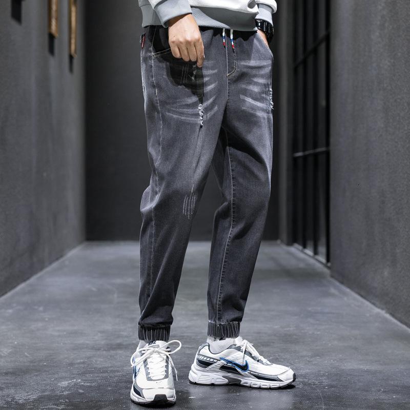 Jeans dos homens novos do outono e do inverno com leggings soltos do hemline
