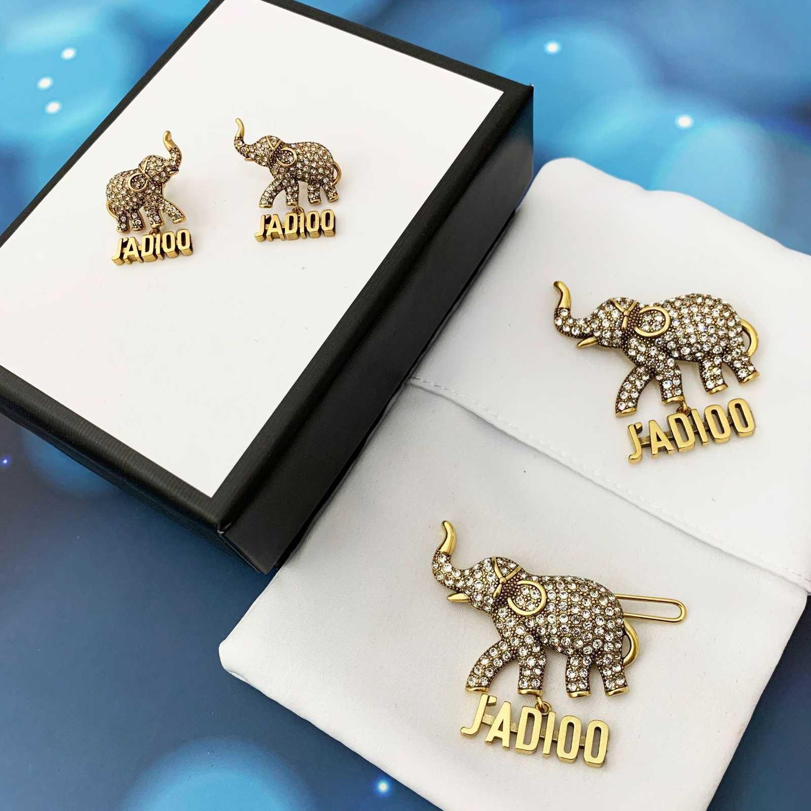 d 2021 de la famille 2021 nouveaux diamants incrustations et boucles d'oreilles femelles Dijia net Broche d'éléphant rouge coiffure