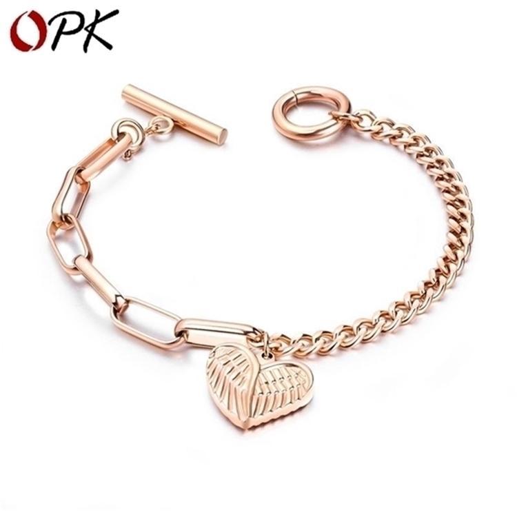 Los anillos de compromiso de los pendientes del diseñador, las pulseras y los collares de oro son los favoritos de las mujeres enlazan, cadena de accesorios populares de la moda mujer de titanio chapado en acero rosa