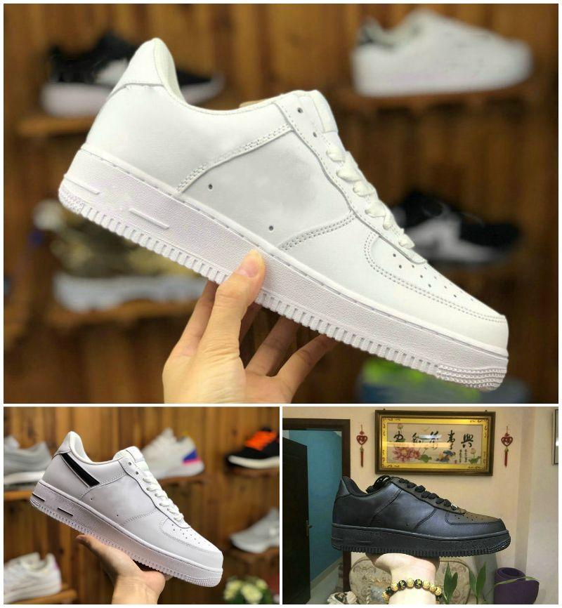 أعلى جودة 2021 المصممين في الهواء الطلق الرجال المنخفضة لوح التزلج أحذية واحدة للجنسين 1 متماسكة اليورو نساء أبيض جميع المدربين السوداء الأحذية الرياضية C210