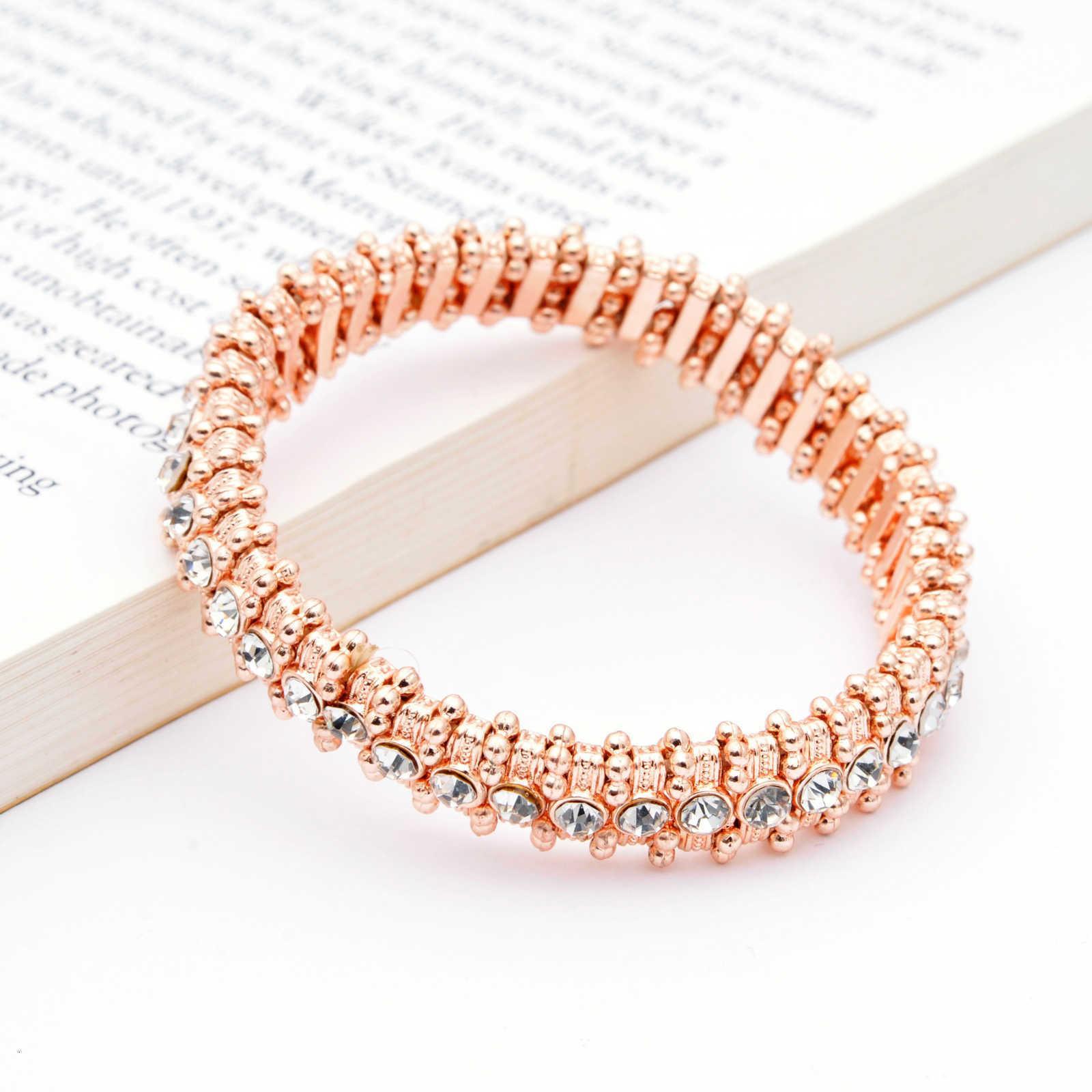 Los anillos de compromiso de los pendientes de diseño, pulseras y collares de oro son favoritos de las mujeres pulseras de encanto de encanto aleación eólica elástica de diamante completo rosa pulsera de los hombres