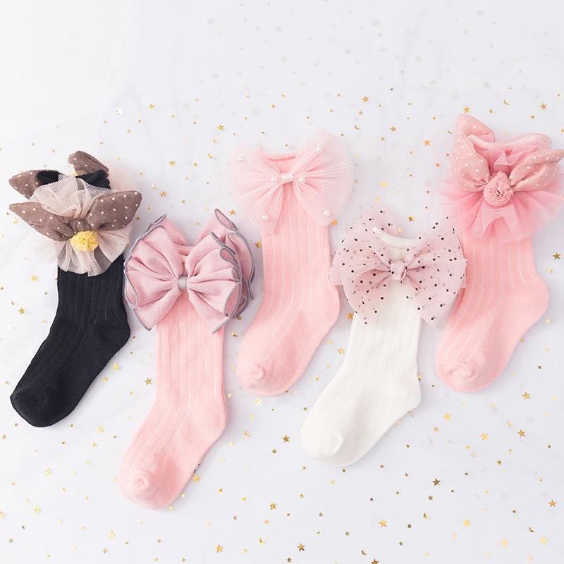 Носки мода младенца с луками принцесса девушки мультфильм бантик колена высокий мягкий хлопок малыши длинные