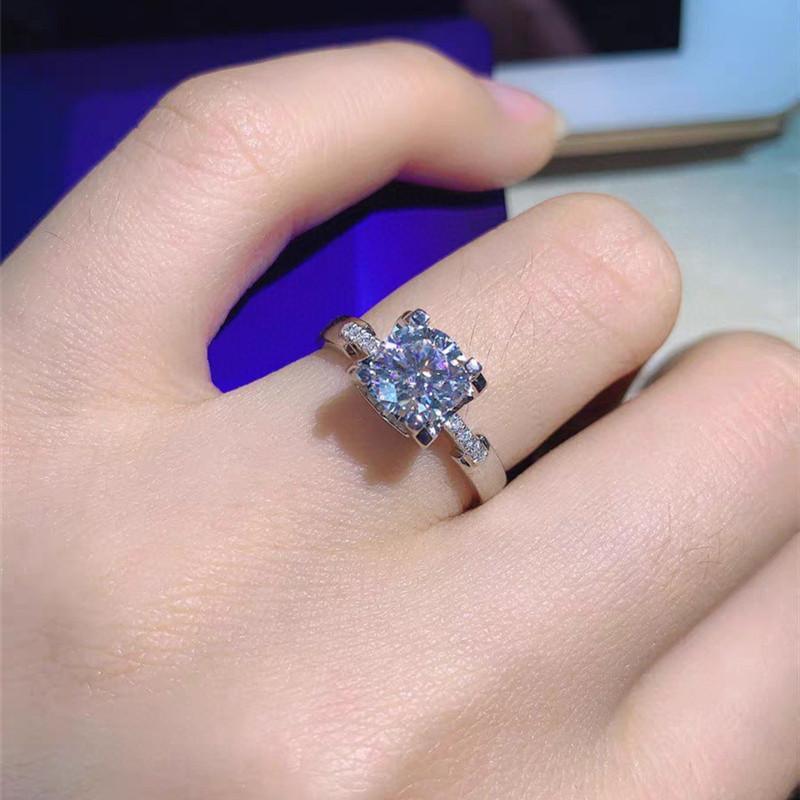 Anel de moda GEOKI 925 Sterling Prata Perfeito Corte 1CT D Passed Diamond Test Moissanite VVS1 Excelente Qualidade Gem Wedding Mulheres Anéis N1