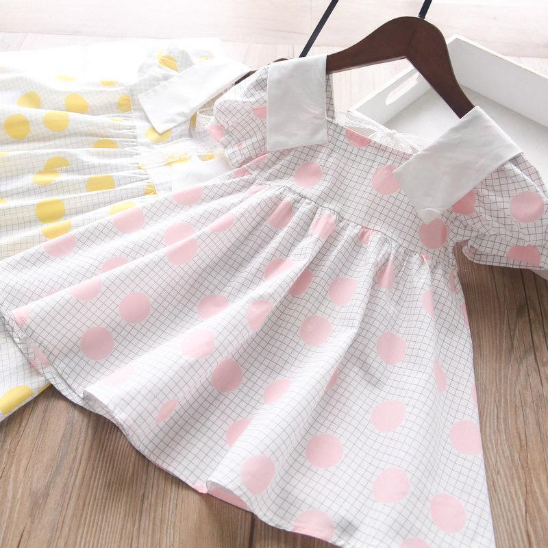 Baby-Mädchen tragen karierte Revers-Kleider-Kleider des Kleides