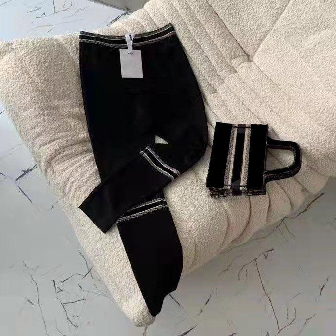 Женщины отслеживают брюки Леггинсы Мода стиль свитер нижний улица носить свободную леди Slim Capris Нижние буквы напечатаны боковым рисунком Trous