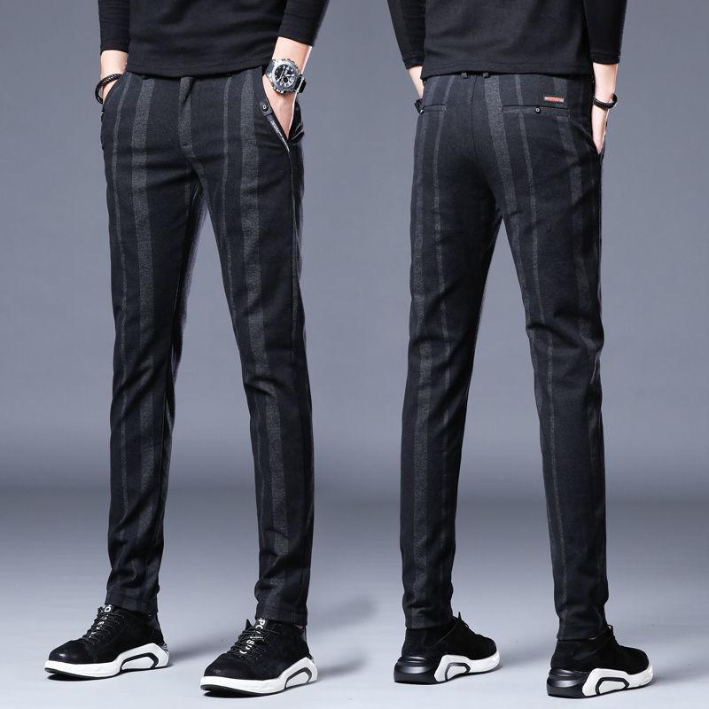 Pantalón elástico nuevo delgado de la primavera de los hombres pantalones de pierna coreana de los pantalones negros