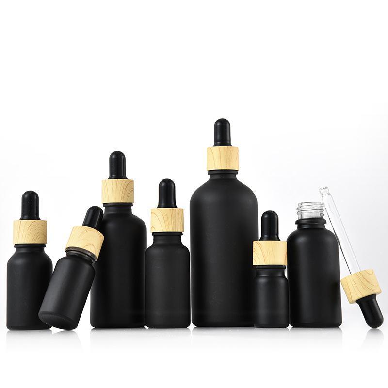 Bouteille de goutte-gouttes en verre recouvert mat mat boston rond huiles essentielles flacons de parfum avec bouchon en plastique à grains de bois
