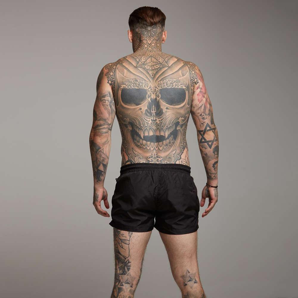Pantaloni di asciugatura rapidi della spiaggia d'estate, pantaloncini muscolari di sport, formazione per la permeabilità dell'aria degli uomini, fitness