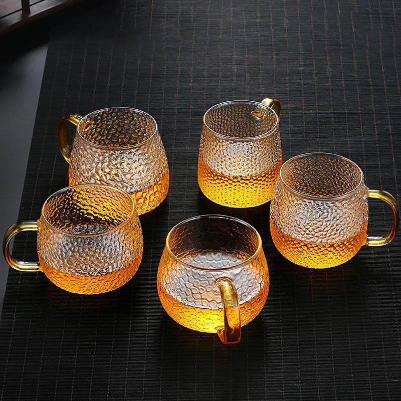 Taza de vidrio de taza de agua con mango de oro patrón de martillo jugo de café taza de leche taza de drinkware regalo de casa copas de vino