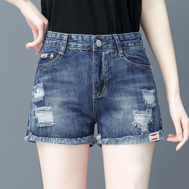 Pantalones cortos de mezclilla VERANO DE MUJERES 2021 Agujero suelto High Cintura Alta Versátil delgada A-Line Pantalones calientes