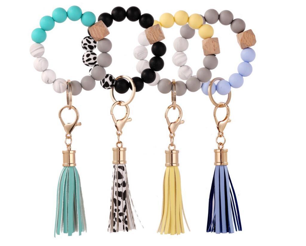 Женщина дизайнерские сумки силиконовые кольцевые кольца браслет, автомобиль брелок бисец браслет брелок браслет кожаный кисточка для женщин и девочек