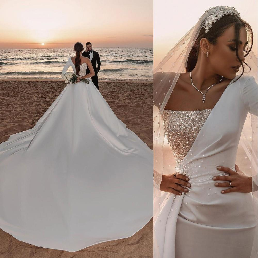 2021 Stunning Ivory Mermaid Wedding Dresses Bridal Gowns Arabic Dubai Backless Overskirts Long Sleeve Detachable Train Formal Sexy One Shoulder Silver Sequins