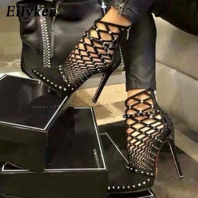 Eilyken 2020 Gladiator Sandalen Sommer Frühling spitz Nieten Nieten ausgeschnittene Käfig Knöchelstiefel Stiletto Ferse Frauen Schuhe Y200623