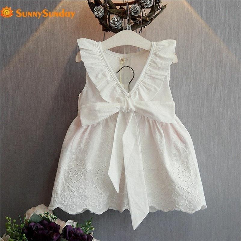 Ins Pure White Dress Verão Meninas Vestidos Big V Hollow Batterless vestido com laço um vestido ondulado do joelho-comprimento 210319