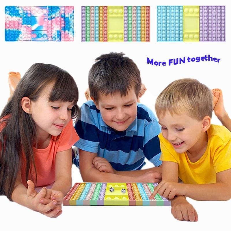 Büyük boy fidget oyuncaklar okul çantası kurulu için push onu sıcak yetişkin stres kabartma oyuncak aile masa tahta oyunları