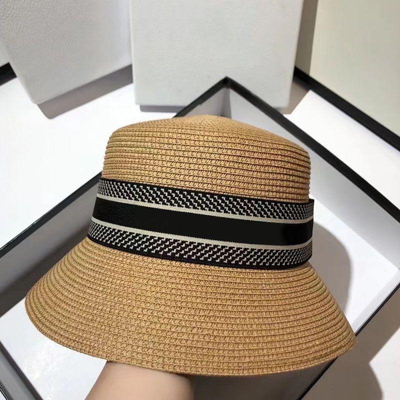 Mujeres Summer Beach Hat Designers De Moda Amplio Amplio Paja Sombrero Sombrero para mujer Gorras de cubo de tejido casual Tapas de rayas