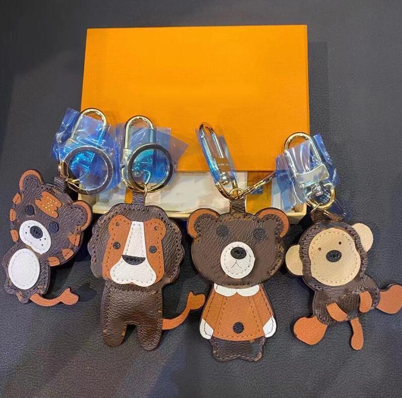 2021 Designer Leão Tigre Macaco Urso Keychain Laser Bag Embossed Pingentes com Caixa Chaveiros PU Couro Animal Carros 1853