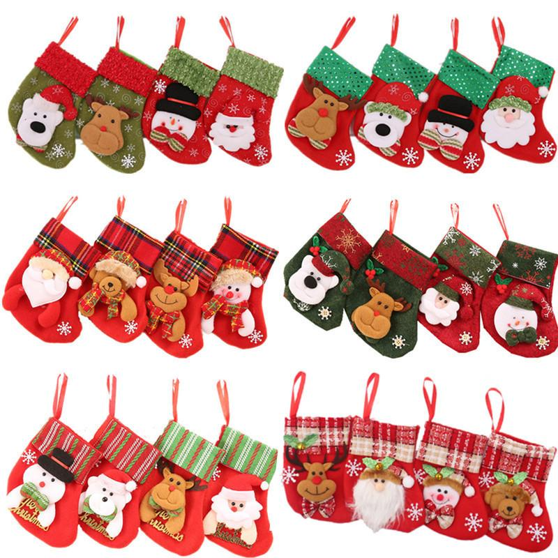 Moda de Natal desenhos animados boneco de neve deer urso santa claus meias decoração de árvore festival saco de presente pingente