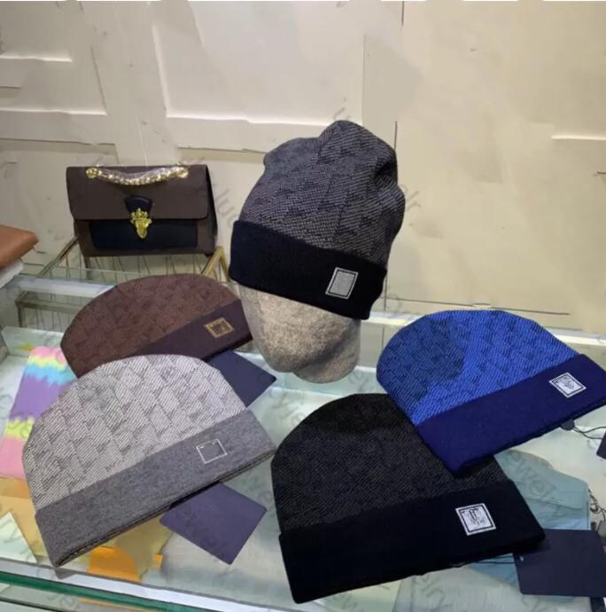 Классический дизайнер зимний шанс мужчины и женщины мода дизайн вязаные шапки осенняя шерсть шляпа буквы жаккарда унисекс теплый череп шапка
