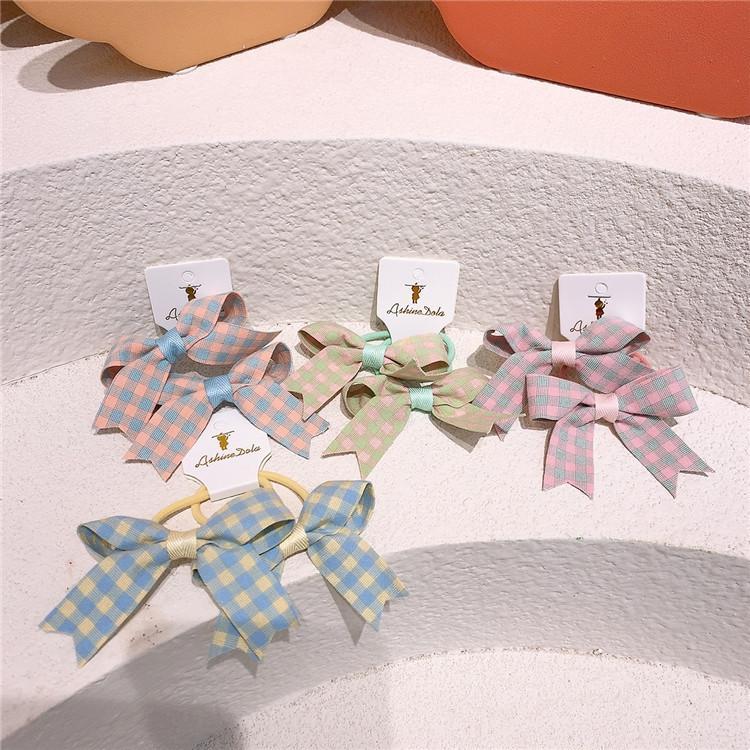 1 paire nouvelle mode coréen Tissu pour enfants treillis arc de caoutchouc corde de coiffure douce fille princesse queue de queue de queue de cheval