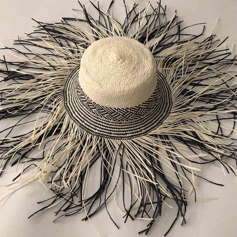 عارضة جديد اليدوية النساء القش قبعة الشمس كبيرة واسعة بريم فتاة عالية الجودة الطبيعية raffia بنما شاطئ قبعات الشمس قبعات لقضاء 210323
