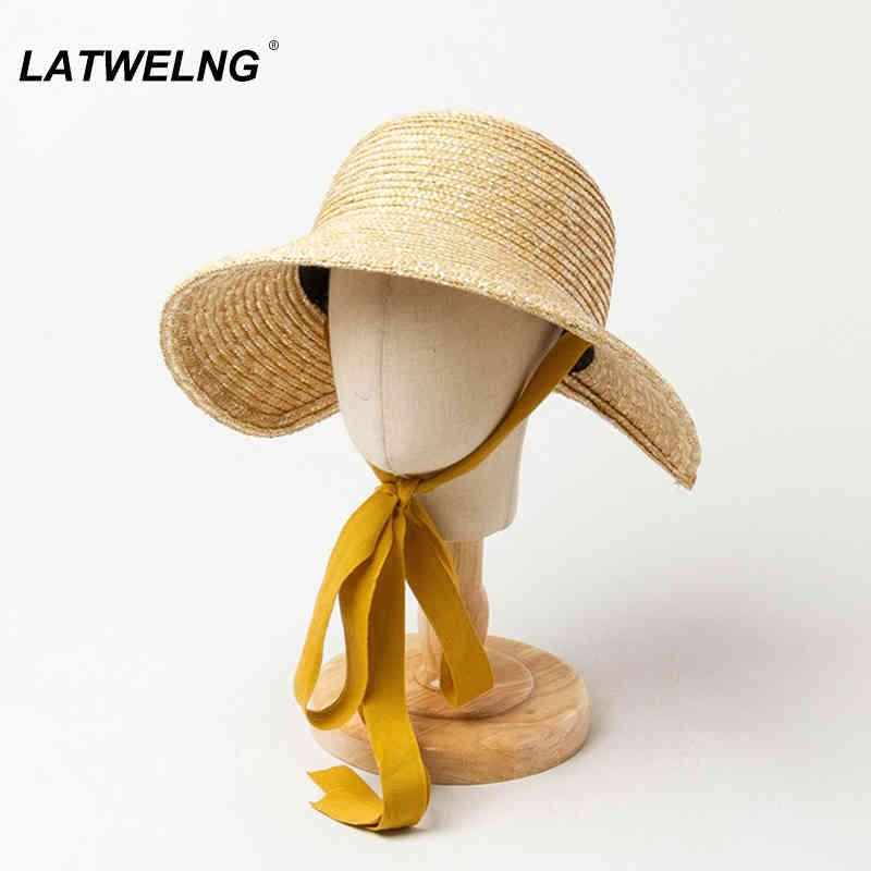 جديد الأطفال الصيف القش القش الشمس الفتيات قبعة الشاطئ رحلة uv حماية قبعة مع الشريط طويل أطفال دلو القبعات بالجملة S1166 210323