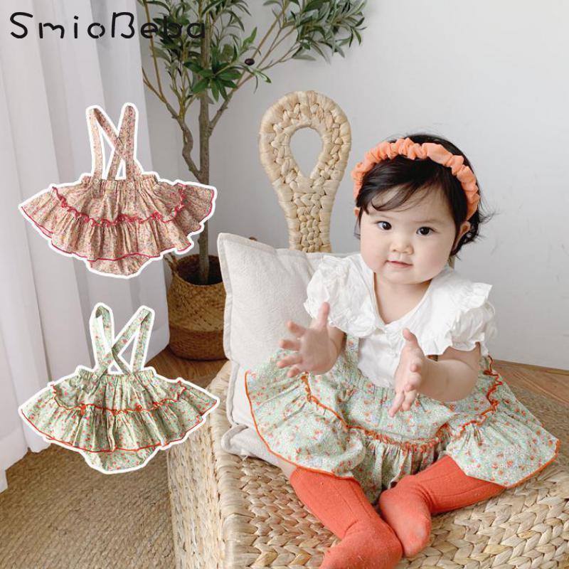 Falda de verano Baby Girl Dos Piezas Conjuntos Cinturón Plisado Suspender Princess Mampers + Camisas Blancas Floral 2pcs Traje Roupa Infantil Ropa