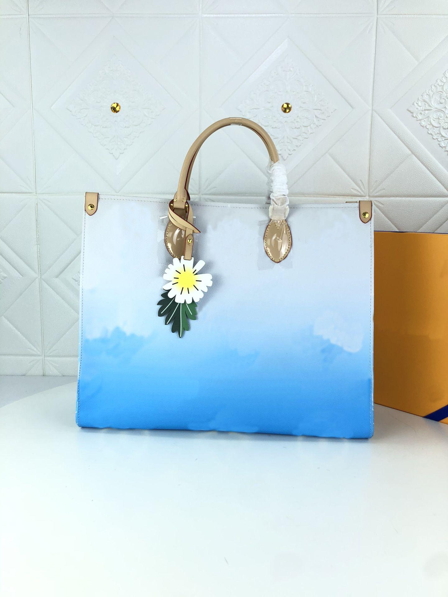 M57640 M57641 M57639 Ontego GM sacolas Accessorized com um charme de flor de couro colorido pela saco de piscina Womens Lidar com alças de ombro Senhoras Bolsa de negócios