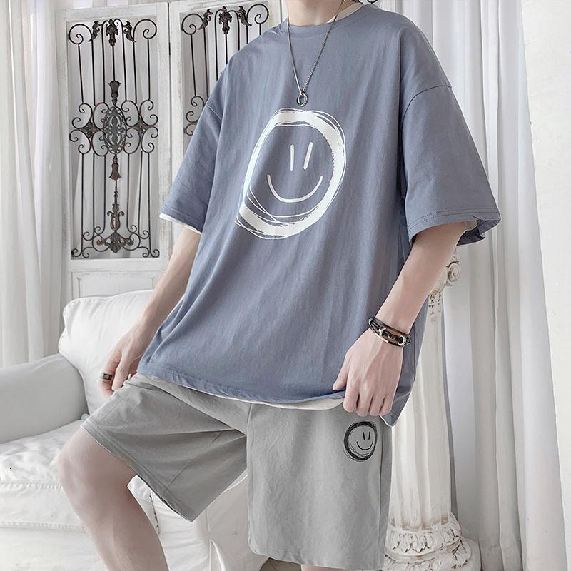 Traje de los hombres Trande de verano TRAJETSUIT suelto coreano manga corta camiseta de moda Marca de moda deportes pantalones cortos guapo Use un conjunto de colocación