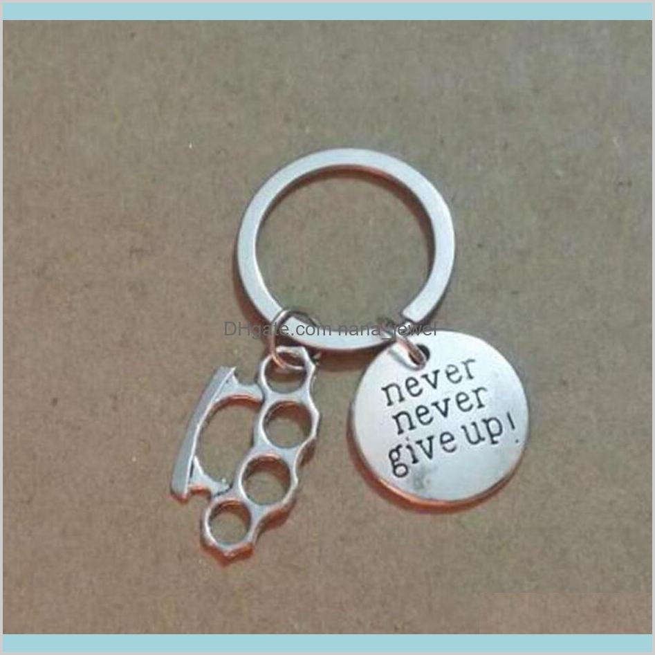 Non rinunciare mai in ottone spolverato da polveri in lega di metallo portachiavi per chiavi sacchetto di auto portachiavi anello borsetta coppia catene key jewelry uomo regali 705 yel u5nlt