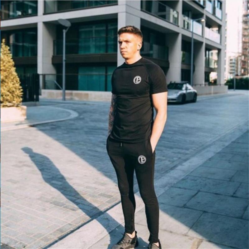 Nueva camiseta para hombre camisas de algodón gimnasios fitness culturismo delgado hombres de manga corta entrenamiento masculino casual tees tops camiseta masculina