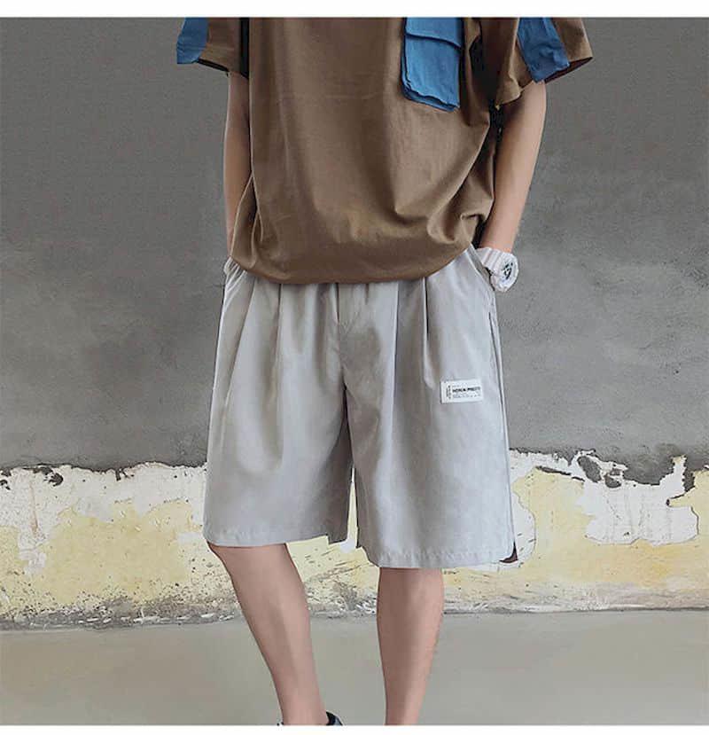 Pantalones cortos Hombres sueltos Casual Coreano estilo Hong Kong Estilo Cinco Pantalones Góticos Pantalones Góticos Joggers Mujeres Capris Ropa Talla grande 210525
