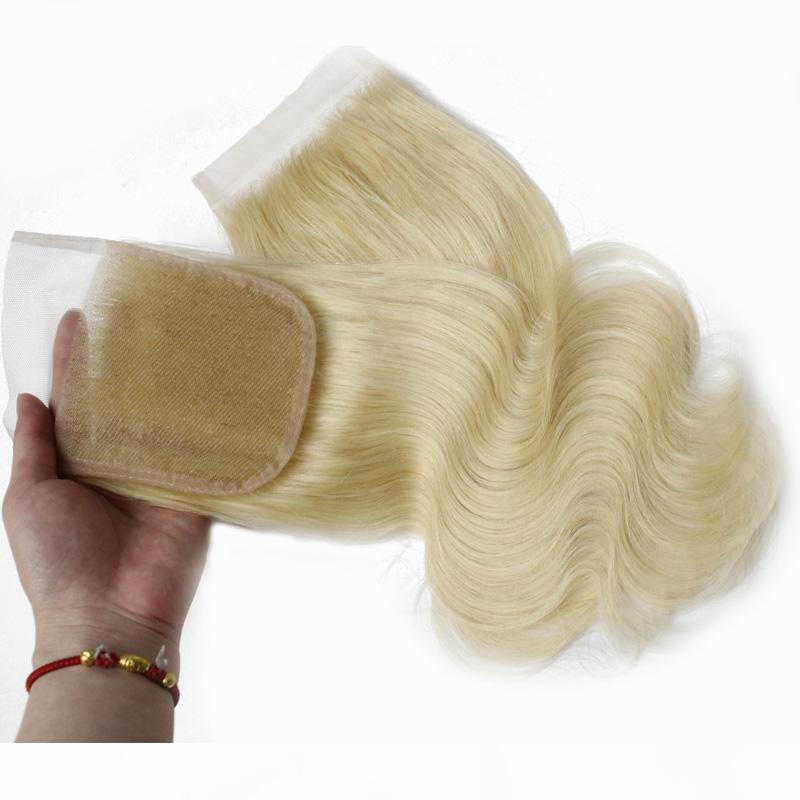 Remy retas superiores de fechamento do corpo da onda do corpo de fechamento do cabelo da onda do corpo da parte livre 4x4 Brazilian Virgem cabelo suíço fechamento de laço # 613 nós branqueados