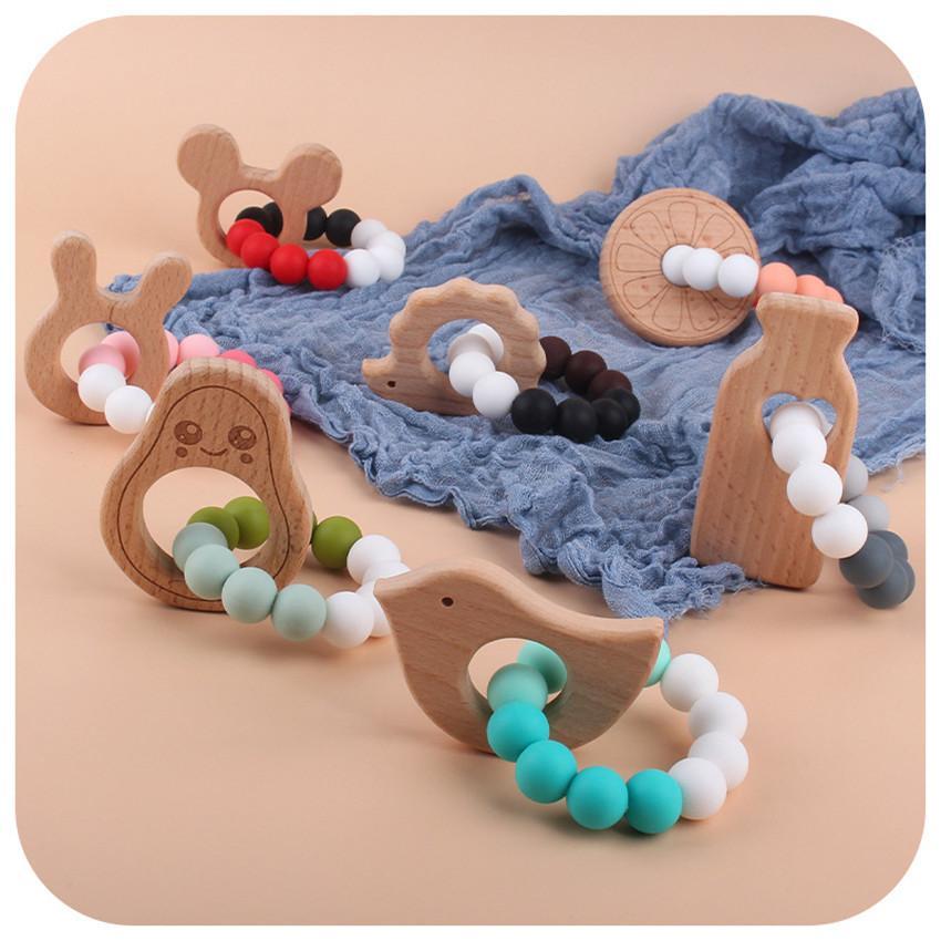 Diente de silicona bebé infantil niños toether diestro dibujos animados de madera anillo de madera botella de alimentación aguacate chupetal chupete bead masticar juguete