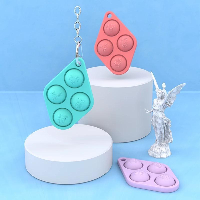 Fidget de la mano de la mano de alivio del estrés de los juguetes del hoyjo simple para los niños adultos temprano autismo educativo llavero colgante