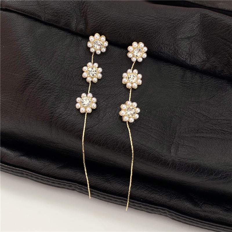 2021 cadena larga simulada-perlas flores pendientes de clip de moda chicas moda brillante cúbico circón