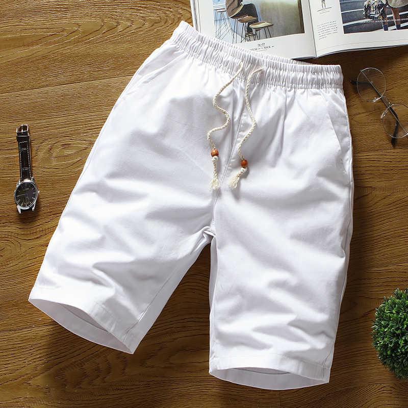 Gatos de verano para pareja grande, efecto color broek hombres / blanco derecho hombres sueltos respirando la cola elástica shortsjnfujnfu