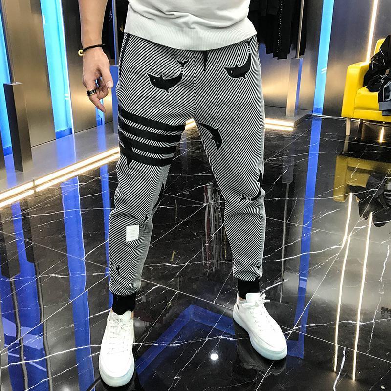 Pantalones deportivos de Europa 2021 Marca de moda de otoño Fresco con patas de delfín Four Bar Gris Personalizado Casual para hombres Hombres