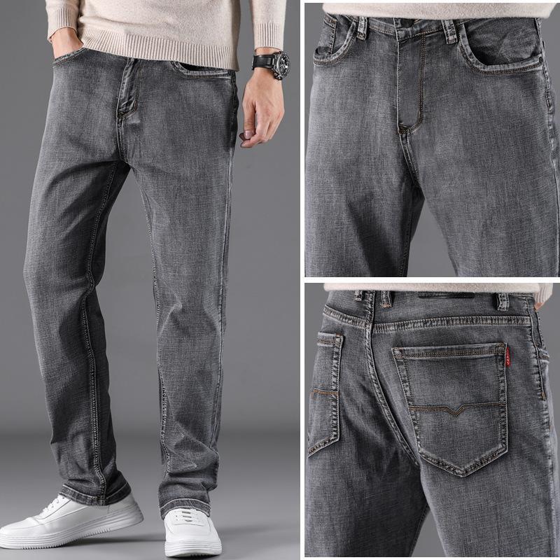 Alto estiramiento ahumado gris pantalones vaqueros sueltos heterosos grasas de piernas de pierna ancha y otoño.