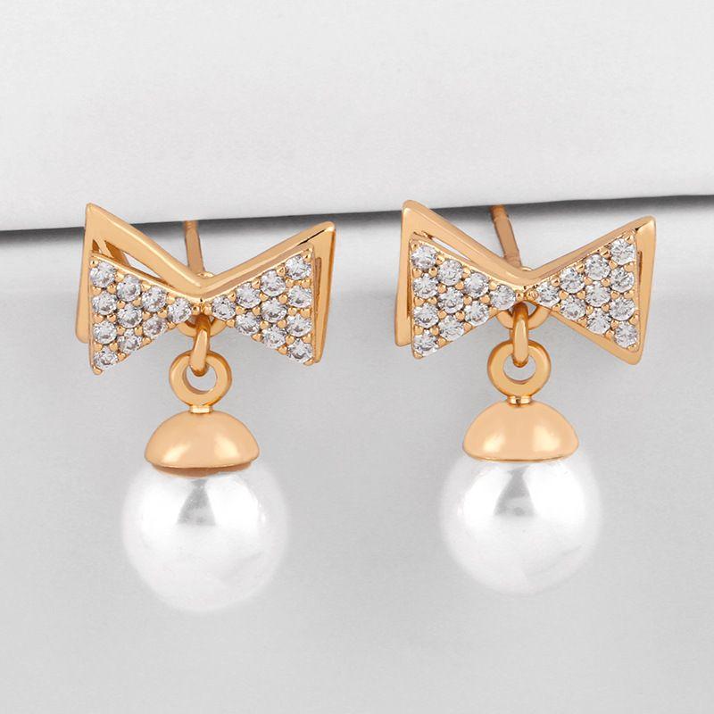 디자이너 한국 동 디멘 기질 Bowknot Pearl 여성 성격 패션 귀걸이 마이크로 상감 지르콘 귀걸이 Eru25