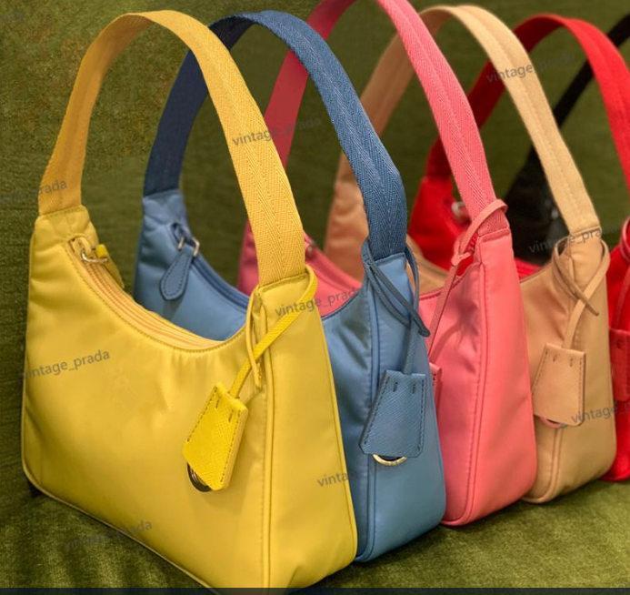 En Kaliteli kadın Lüks Tasarımcısı Kozmetik Çantaları Tote Kılıfları Tote Naylon Cüzdan Moda Deri Kız Hediye Omuz Debriyaj Çanta Çanta Çanta Hobo Crossbody Çanta