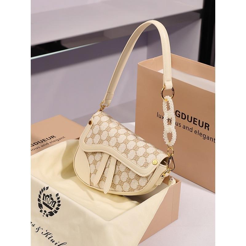 프랑스 소수 민족 디자인 높은 감각 겨드랑이 여성 여름 새로운 패션 외국 스타일 싱글 숄더 메신저 안장 가방